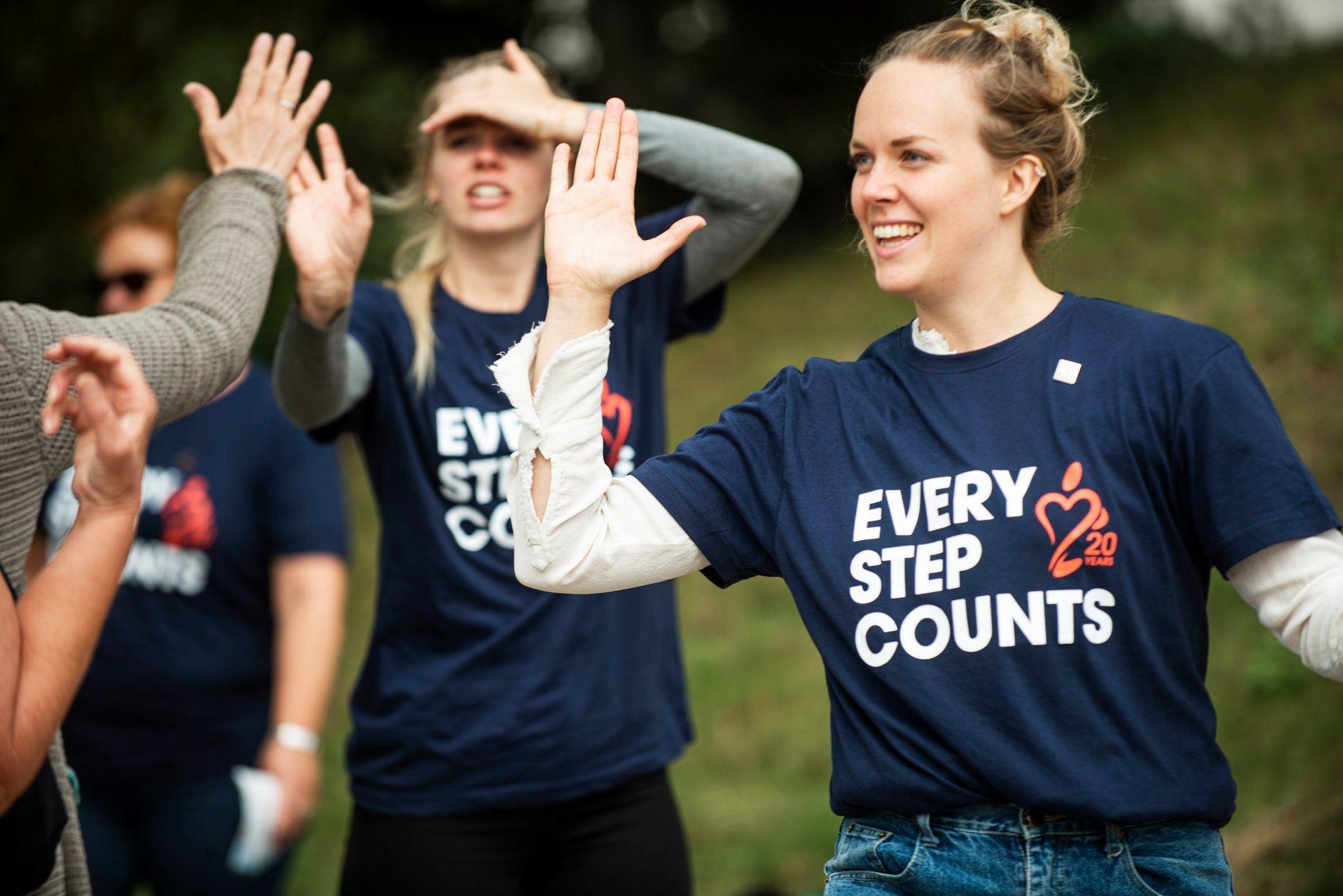 Walkathon participants giving high-fives.