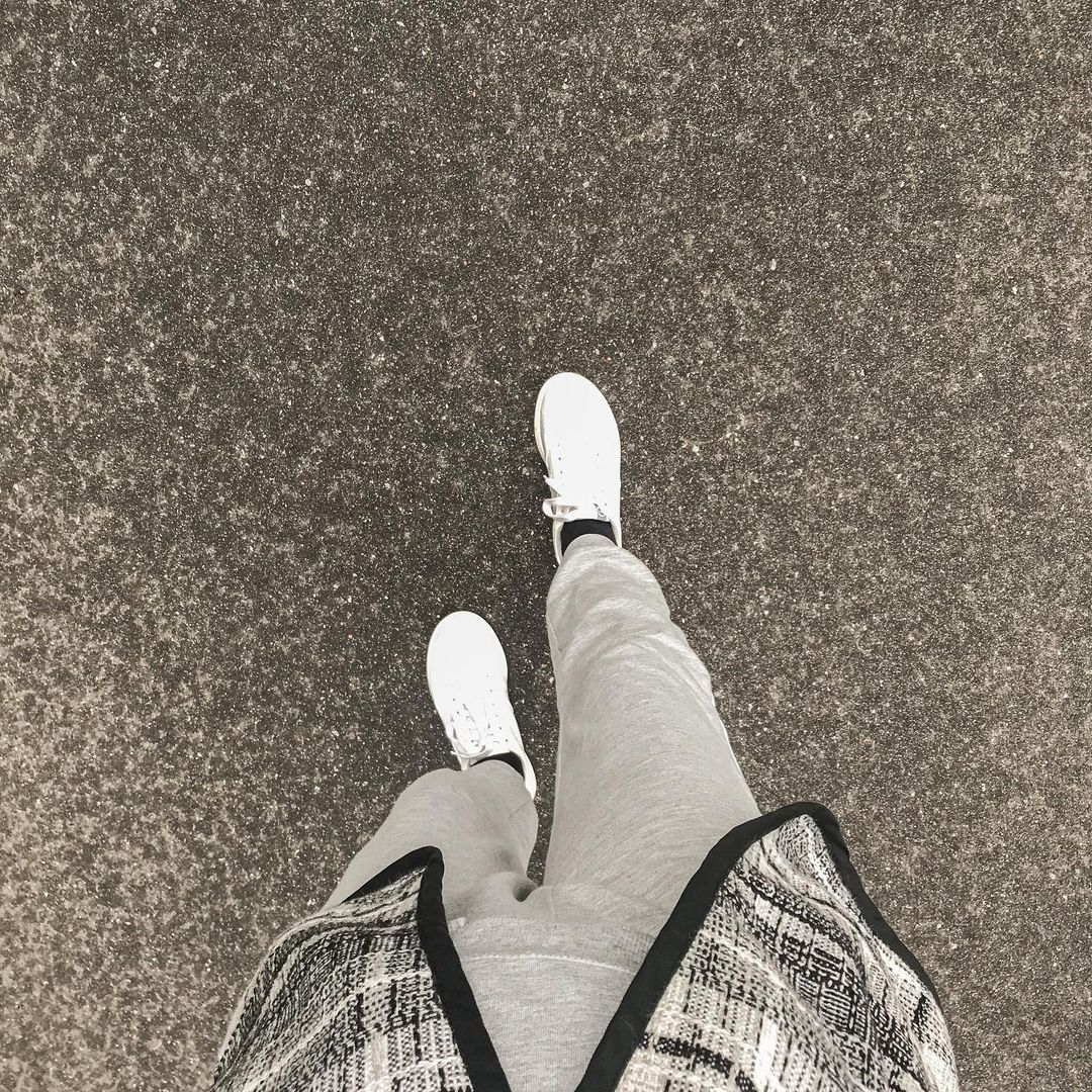 Top down view of shoes walking on a road