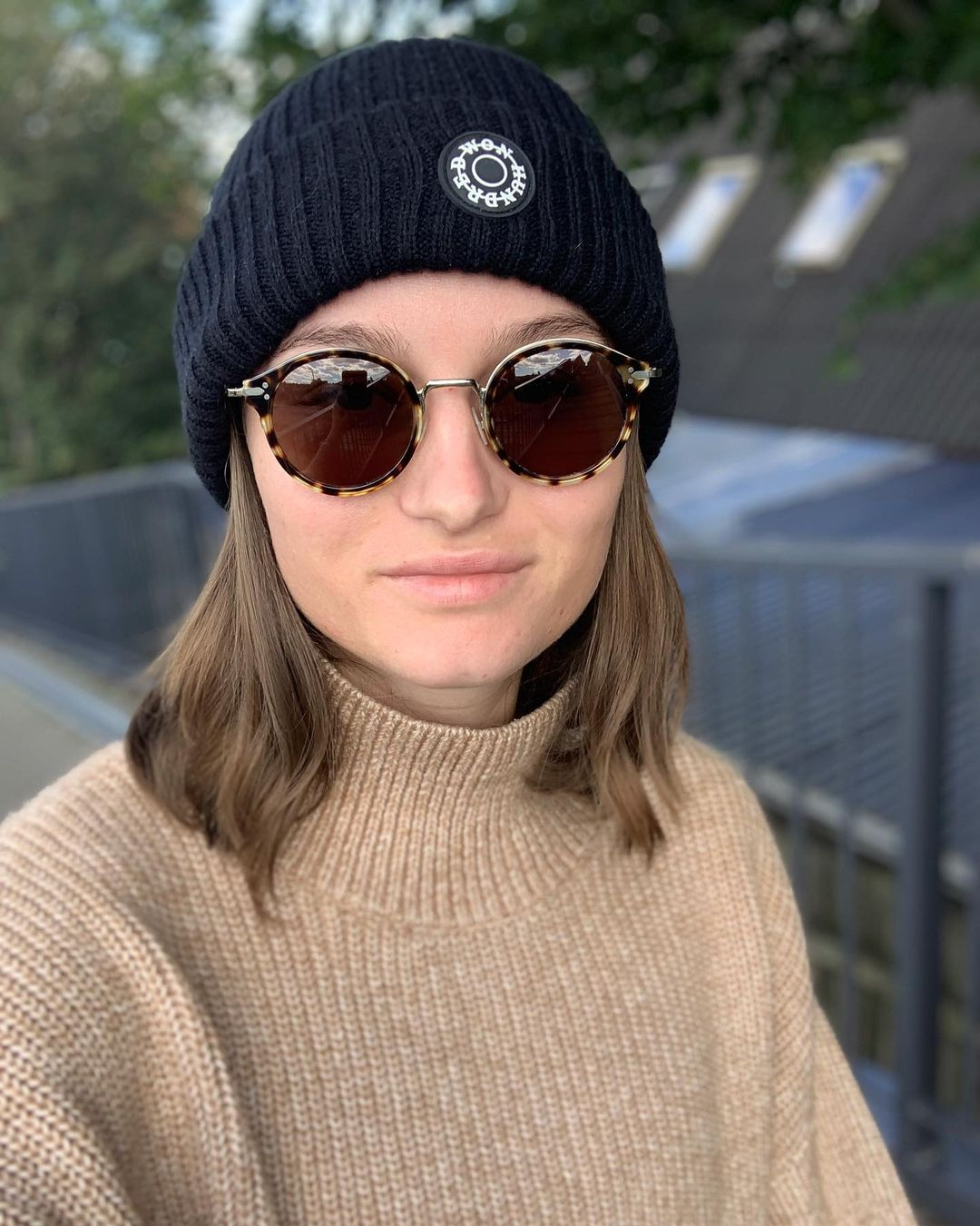 Selfie image with sunglasses and a hat