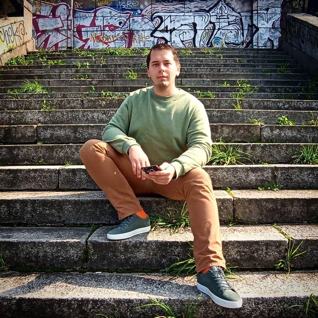 Valdemar Vasilevski sitting on a staircase